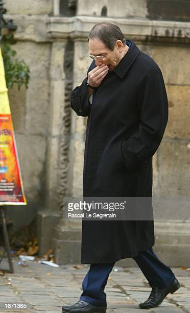 French director Robert Hossein attends the funeral services for French actor Daniel Gelin December 4 2002 in Paris Gelin known best to English...