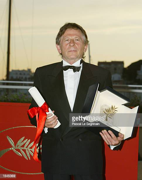 French director Roman Polanski holds his Palme d''Or award at the 55th Cannes Film Festival May 26 2002 in Cannes France Polanski won the award for...