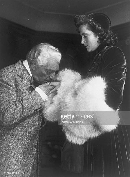 French Director Sacha Guitry Kissing Lana Marconi's Hand