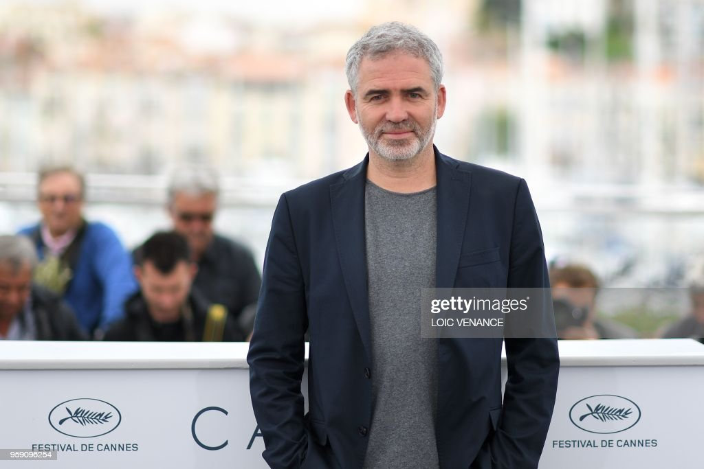 French director Stephane Brize poses on May 16, 2018 during a photocall for the film 'At war (En Guerre)' at the 71st edition of the Cannes Film Festival in Cannes, southern France.