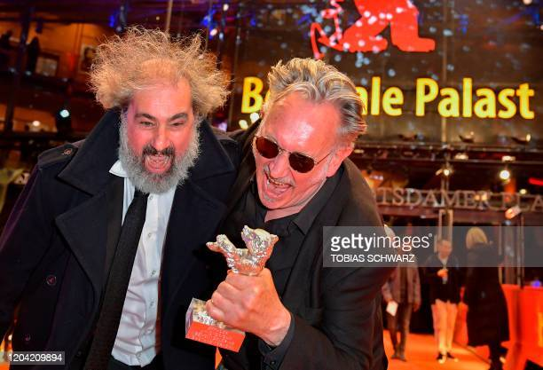 French directors Benoit Delepine and Gustave Kervern react after receiving The Silver Bear 70th Berlinale on the red carpet after the awarding...