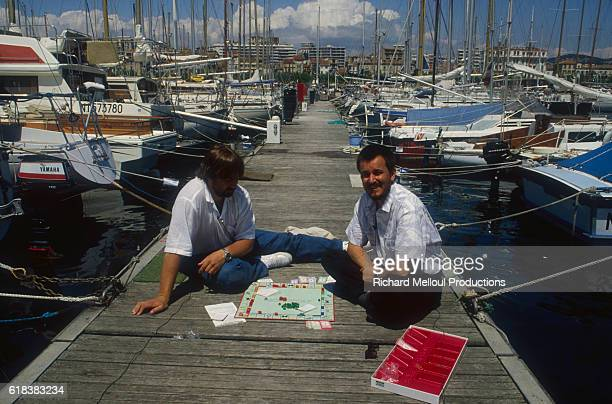 French directors Luc Besson and Jean-Jacques Beineix play the popular board game Monopoly on a pier at Cannes.