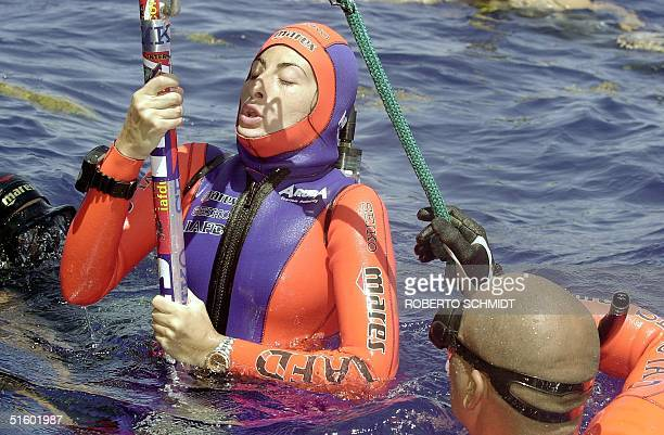 French diver Audrey Mestre Ferreras takes a last deep breath as she is assisted by her husband and freediving master Pipin before she succesfully...