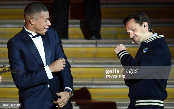 TOPSHOT French DJ and cohost Martin Solveig speaks with French forward Kylian Mbappe during the 2018 Ballon d'Or award ceremony at the Grand Palais...
