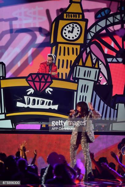French DJ David Guetta and British singersongwriter Charli XCX perform during the 2017 MTV Europe Music Awards at Wembley Arena in London on November...