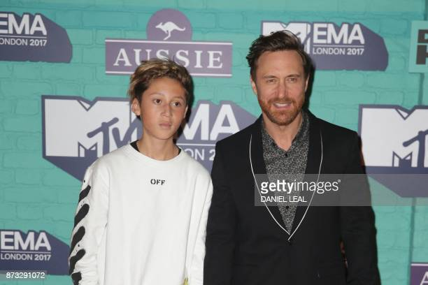 French DJ David Guetta and his son Tim pose on the red carpet arriving to attend the 2017 MTV Europe Music Awards at Wembley Arena in London on...