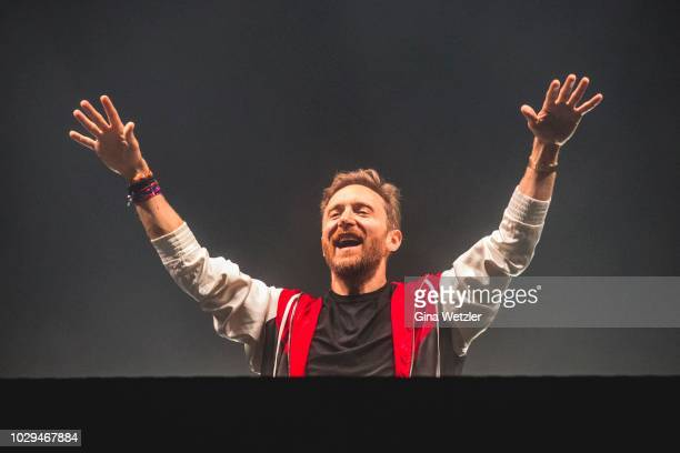 French DJ David Guetta performs live on stage during the first day of the Lollapalooza Berlin music festival at Olympiagelände on September 8 2018 in...
