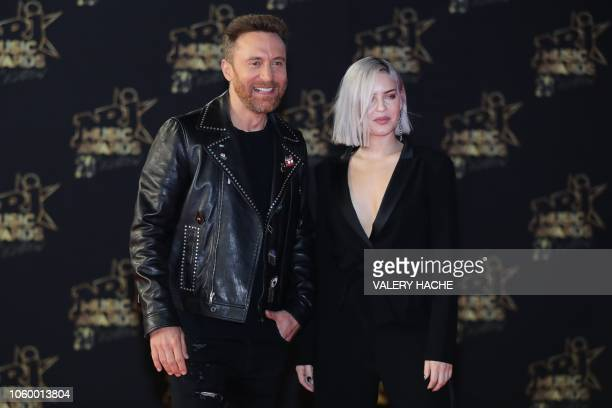 French DJ David Guetta poses with British singer AnneMarie Nicholson aka AnneMarie on the red carpet upon his arrival to attend the 20th NRJ Music...