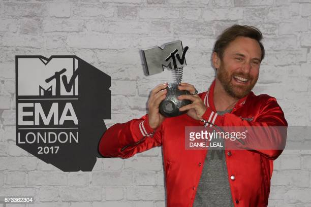 French DJ David Guetta poses with the award for best electronic act in the winners' area during the 2017 MTV Europe Music Awards at Wembley Arena in...
