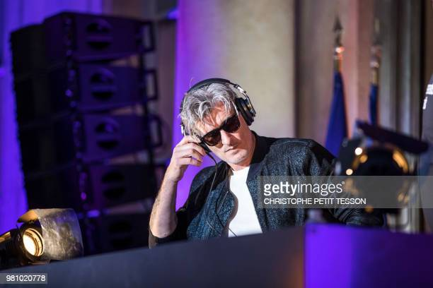 French DJ Kavinski performs during the 'Fete de la Musique' the music day celebration in the courtyard of the Elysee Palace in Paris on June 21 2018...