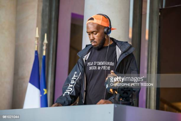 French DJ Kiddy Smile wears a teeshirt reading 'Immigrant's son black and gay' as he performs during the 'Fete de la Musique' the music day...