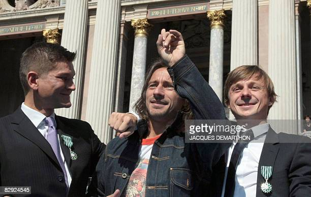 French DJ star Bob Sinclar poses flanked by Antoine Baduel head of the FG Dj radio and French musician Martin Solveig both decorated by the order of...