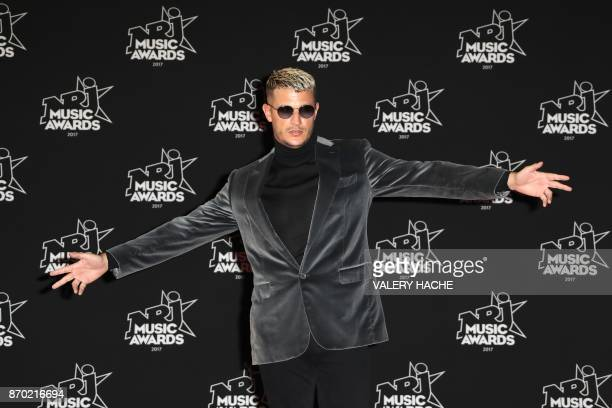 French DJ William Grigahcine aka DJ Snake poses upon his arrival to attend the 19th NRJ Music Awards at the Palais des Festivals in Cannes...