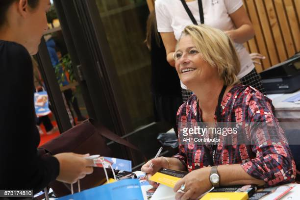 French doctor and TV host Marina Carrere D'Encausse signs her book during the 36th edition of the 'Foire du Livre de Brive' book fair on November 12...