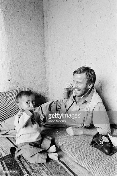 French doctor Bernard Kouchner cares for Afghan children in Wardak ProvinceFrench doctor Bernard Kouchner cares for Afghan people in Wardak Province...