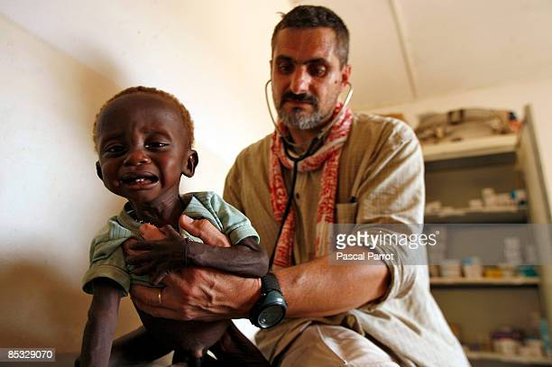 French doctor of the NGO with a child in the community health center on March 6 2009 in Kanazi NigerThe village of 350 people at 30 kilometers...
