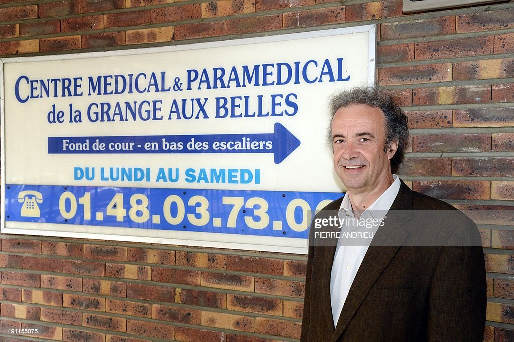 French Doctor Pierre Yves Traynard Poses At The Entrance Of The