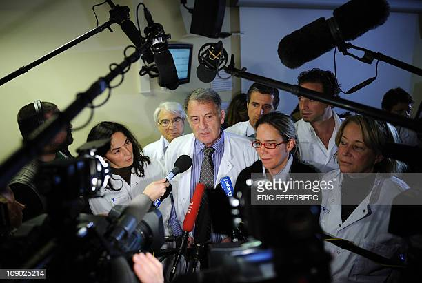 French doctor Rene Frydman , speaks during a press conference, next to French doctor Frederic Lamazou , French professor Nelly Achour-Frydman ,...