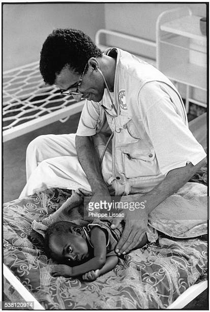 French Doctor Treating Burundi Child With Malaria