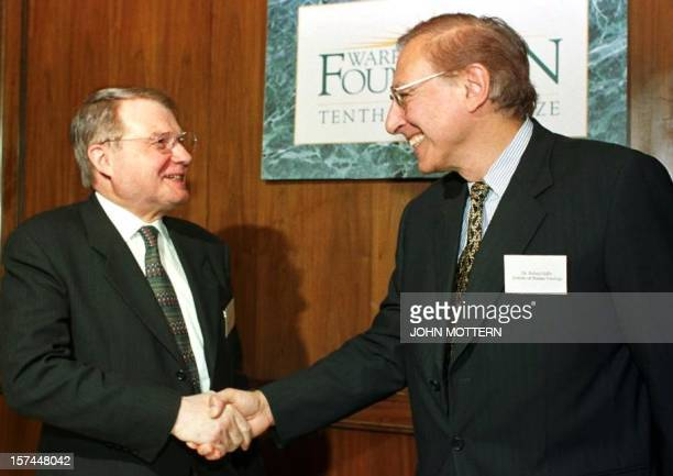 French doctors Dr Luc Montagnier of Queens College Flushing NY and the Pasteur Institute Paris and Dr Robert C Gallo of the University of Maryland at...