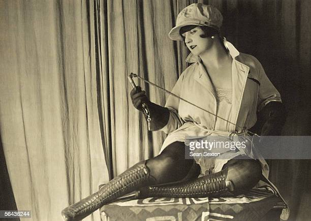 A French dominatrix flexes her whip in anticipation of erotic ecstasy circa 1920