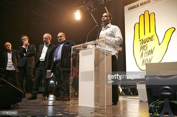 French Dominique Sopo, head of the French association against racism, SOS Racisme delivers a speech next to French journalist Serge Moati ,...