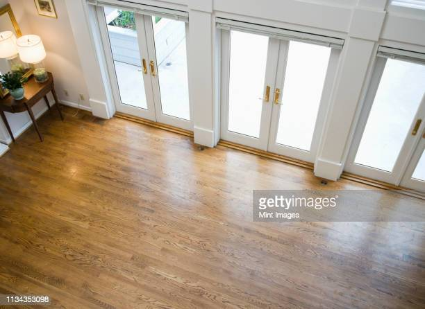 french doors lining empty room - laminate flooring stock pictures, royalty-free photos & images