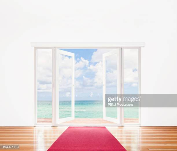 French doors opening onto beach