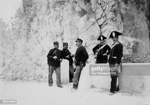 French douaniers or customs officers chat with Italian customs officers and carabinieri or military police on the FrenchItalian front during World...
