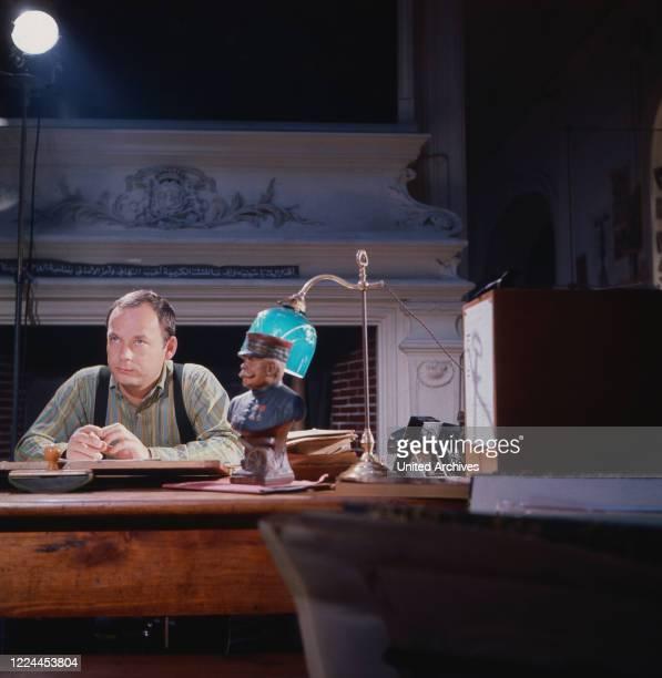 French drawer and satirist Sine, aka Maurice Albert Sinet at his studio in Paris, France around 1962.