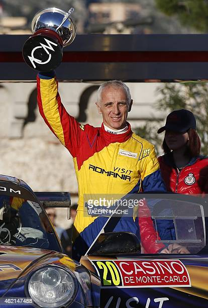 French driver Francois Delecour celebrates on January 25 2015 in Monaco during the podium ceremony after their victory in the 83nd MonteCarlo Rallye...