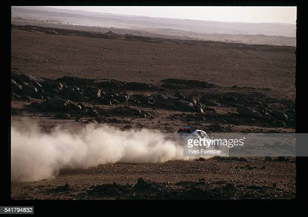 French driver Hubert Auriol's buggy passes through the African desert during the 12th ParisDakar rally