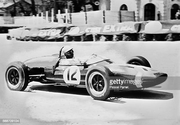 French driver Maurice Trintignant behind the wheel of his Lotus at the 1962 Grand Prix de Pau.