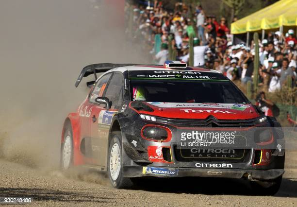 French driver Sebastien Loeb and codriver Monegasque Daniel Elena steer their Citroen C3 during the second day of the 2018 FIA World Rally...