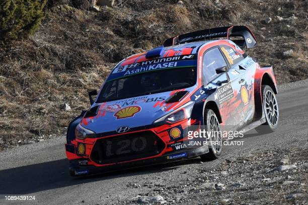French driver Sebastien Loeb and his co-pilot Daniel Elena steer their Hyundai i20 WRC on January 26 during the ES 10 of the third stage of the 87th...