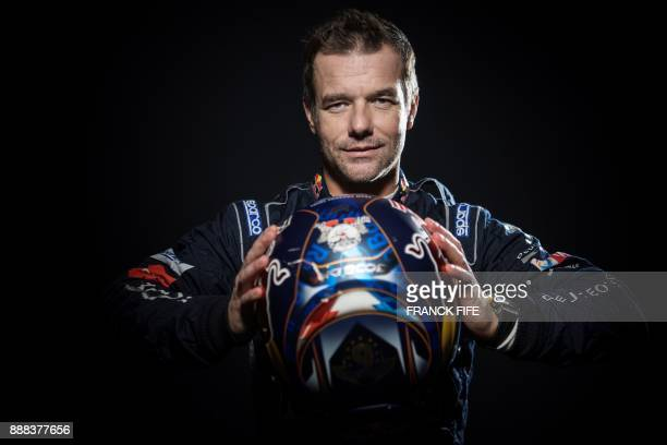 French driver Sebastien Loeb poses during a photo session in Paris on December 7 2017 / AFP PHOTO / FRANCK FIFE