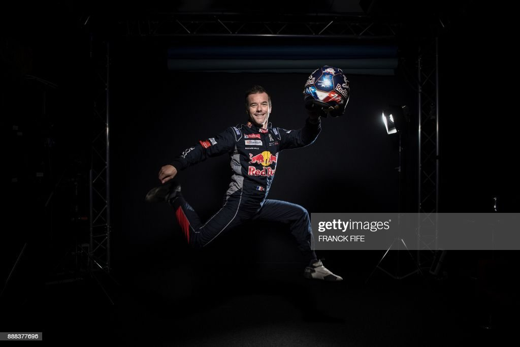 TOPSHOT - French driver Sebastien Loeb poses during a photo session in Paris on December 7, 2017. /