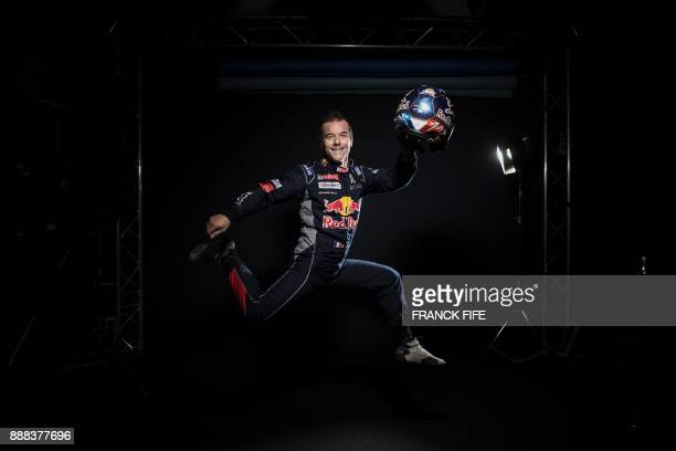 TOPSHOT French driver Sebastien Loeb poses during a photo session in Paris on December 7 2017 / AFP PHOTO / FRANCK FIFE