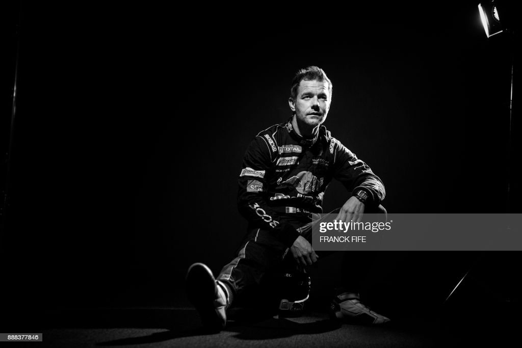 French driver Sebastien Loeb poses during a photo session in Paris on December 7, 2017. /