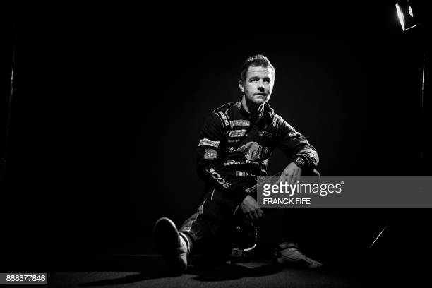 French driver Sebastien Loeb poses during a photo session in Paris on December 7 2017 / AFP PHOTO / FRANCK FIFE / BLACK AND WHITE VERSION