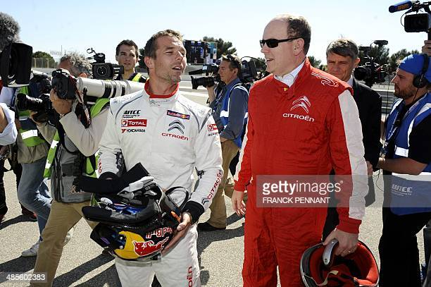 French driver Sebastien Loeb speaks with Prince Albert II of Monaco during the FIA World Touring Car Championship on April 19, 2014 in Le Castellet,...