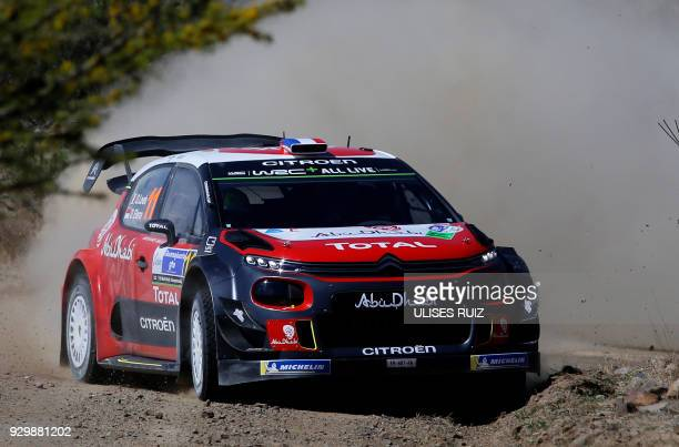 TOPSHOT French driver Sebastien Loeb steers his Citroen C3 with codriver Daniel Elena of Monaco during the first day of the 2018 FIA World Rally...