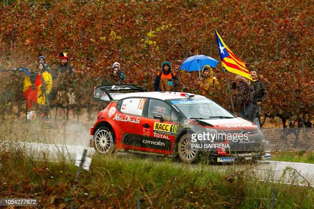 French driver Sebastien Loeb steers his Citroen C3 WRC assisted by Monacan co-driver Daniel Elena during the third day of the Catalonia 2018 FIA...