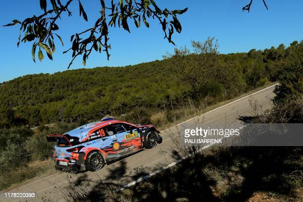 French driver Sebastien Loeb steers his Hyundai i20 Coupe WRC assisted by Monegasque co-driver Daniel Elena during the third day of the Catalonia...