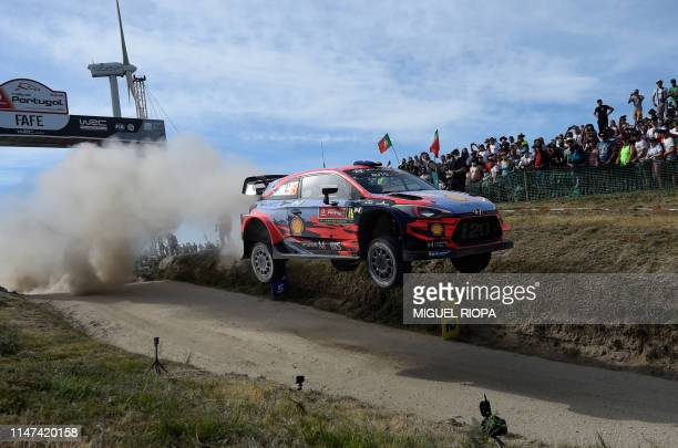 TOPSHOT French driver Sebastien Loeb steers his Hyundai i20 Coupe WRC with Monegasque codriver Daniel Elena during the SS17 stage of the Rally of...