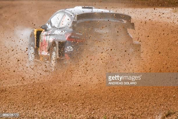 TOPSHOT French driver Sebastien Ogier and codriver Julien Ingrassia drive their Ford Fiesta WRC at Arena motocross of Ittiri village on June 7 during...
