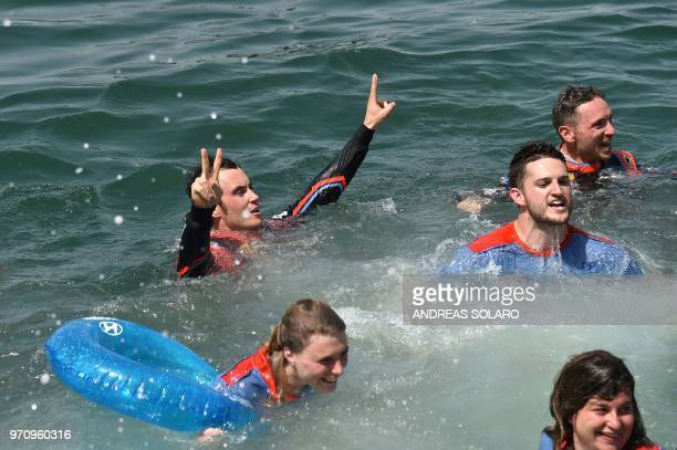 French driver Sebastien Ogier and codriver Julien Ingrassia of Ford Fiesta WRC with their team staff celebrate by swimming after winning the 2018 FIA...