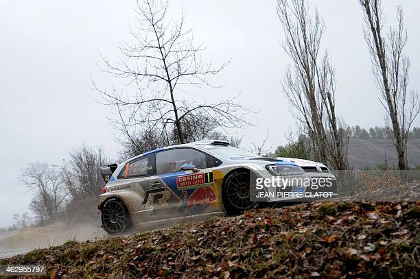 French driver Sebastien Ogier and copilot Julien Ingrassa steer their Volkswagen Polo R on January 16 2014 in Rosans southeastern France during the...