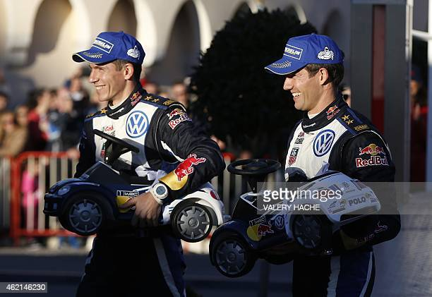 French driver Sebastien Ogier and French codriver Julien Ingrassia give a present for Prince Albert II of Monaco's babies following their victory in...