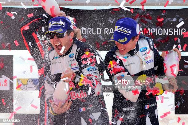 TOPSHOT French driver Sebastien Ogier and French codriver Julien Ingrassia celebrate on the podium after winning the Portugal WRC rally in Matosinhos...